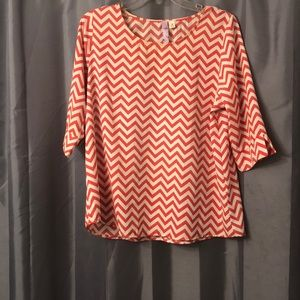 Coral and off white chevron blouse
